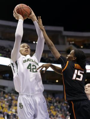 Baylor center Brittney Griner (42) attempts a shot over Oklahoma State' Toni Young (15) in the first half of an NCAA college basketball game in the Big 12 women's tournament on Sunday, March 10, 2013, in Dallas. (AP Photo/Tony Gutierrez)