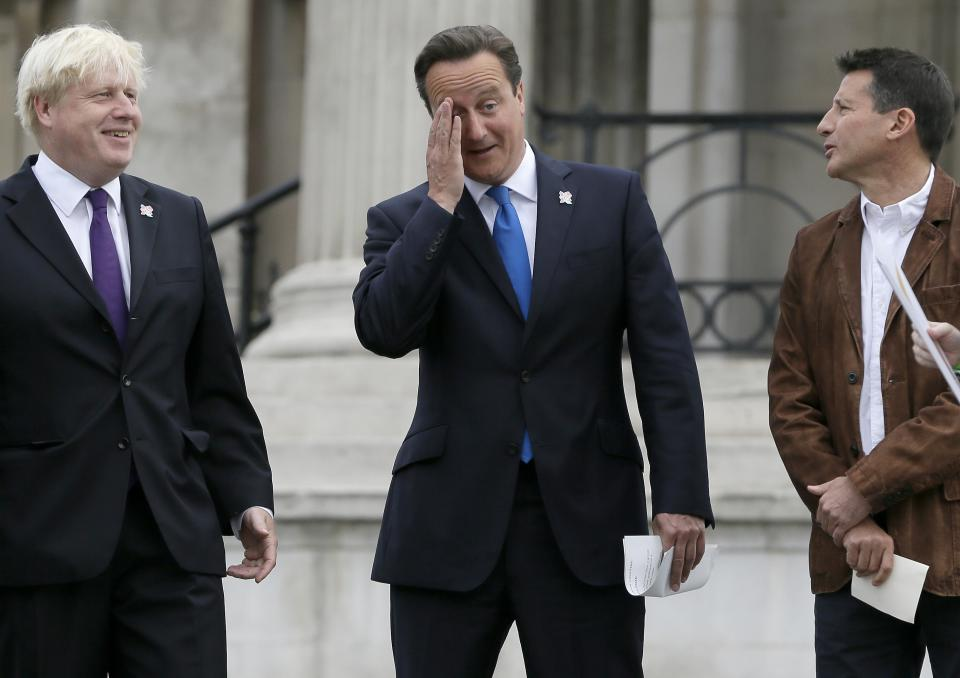 Britain's Prime Minister David Cameron, center, reacts as Boris Johnson, The Mayor of London, left, and Sebastian Coe, Chair of LOCOG, right, look on ahead of the lighting of the Paralympic flame cauldron in Trafalgar Square in London, Friday, Aug. 24, 2012. (AP Photo/Kirsty Wigglesworth)
