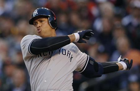 New York Yankees Alex Rodriguez swings through a pitch during the sixth inning of Game 4 of their MLB ALCS baseball playoff series against the Detroit Tigers in Detroit