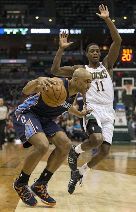 Milwaukee Bucks' Brandon Knight, right, is called for a foul while trying to defend against Charlotte Bobcats' Gerald Henderson during the first half of an NBA basketball game on Sunday, March