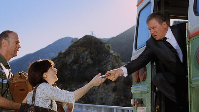 In this image released by priceline.com, William Shatner is shown in a scene from a Priceline.com commercial. In a new commercial, William Shatner's Priceline pitchman, the Negotiator, makes a costly sacrifice for a deal. In a new 30-second TV spot set to begin airing next week, the Negotiator rescues panicked vacationers from a bus teetering on a bridge's railing. (AP Photo/priceline.com)