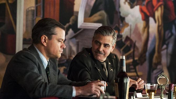 """This film image released by Columbia Pictures shows Matt Damon, left, and George Clooney in """"The Monuments Men."""" A spokesman for Sony Pictures said Wednesday, Oct. 23, 2013, that the film will now be released in the first quarter of next year, instead of its planned release date of Dec. 18. """"Monuments Men,"""" which Clooney directed, co-wrote and stars in, had been expected to be a top Oscar contender. (AP Photo/Columbia Pictures - Sony, Claudette Barius)"""