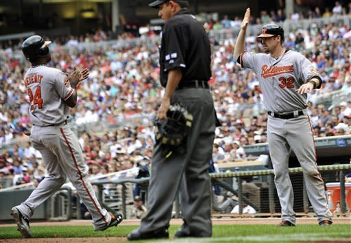 Reynolds comes through, O's beat Twins 4-3