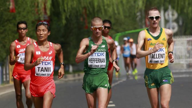 Takayuki Tanii of Japan (L), Robert Heffernan of Ireland (C) and Jared Tallent of Australia compete in the men's 50 km race walk final during the 15th IAAF World Championships at the National Stadium in Beijing
