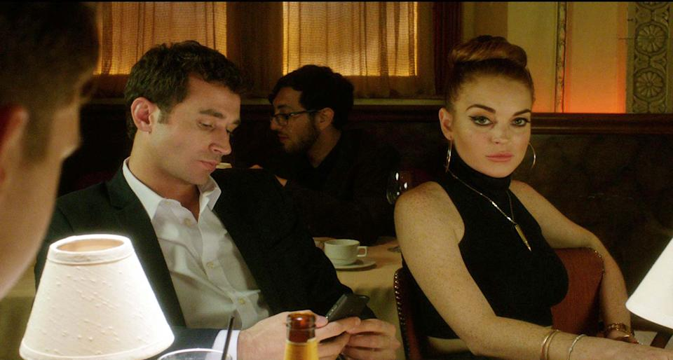"This film image released by IFC Films shows Lindsay Lohan, right, and James Deen in a scene from ""The Canyons."" (AP Photo/IFC Films)"