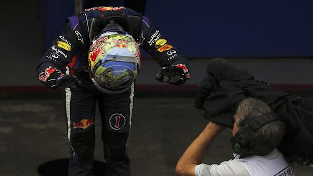 Sebastian Vettel of Germany bows as he celebrates winning the Brazilian Grand Prix (Reuters)