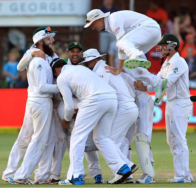 South Africa's players celebrate the winning wicket on the fourth day of their 2nd cricket test match at St George's Park in Port Elizabeth, South Africa, Sunday, Feb. 23, 2014. South Africa b