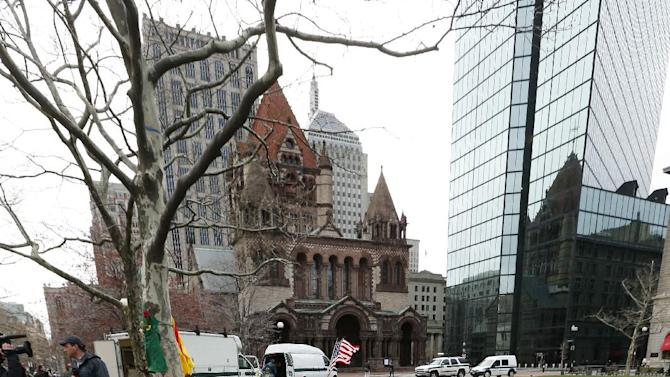 Various items are displayed at a makeshift memorial in Copley Square on Boylston Street in Boston, Wednesday, April 24, 2013. Traffic was allowed to flow all the way down Boylston Street on Wednesday morning for the first time since two explosions on April 15. (AP Photo/Michael Dwyer)