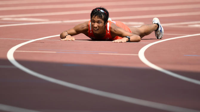 Tanii reacts after finishing third in the men's 50km race walk final at the 15th IAAF Championships in Beijing