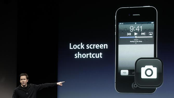 FILE - In this Oct. 4, 2011 file photo, Apple's Scott Forstall, talks about camera on the Apple iPhone 4S during an announcement at Apple headquarters in Cupertino, Calif. Apple Inc., announced Mondy, Oct. 10, 2011, pre-orders of its iPhone 4S have topped one million in a single day, surpassing the previous single day pre-order record of 600,000 held by iPhone 4.(AP Photo/Paul Sakuma, File)