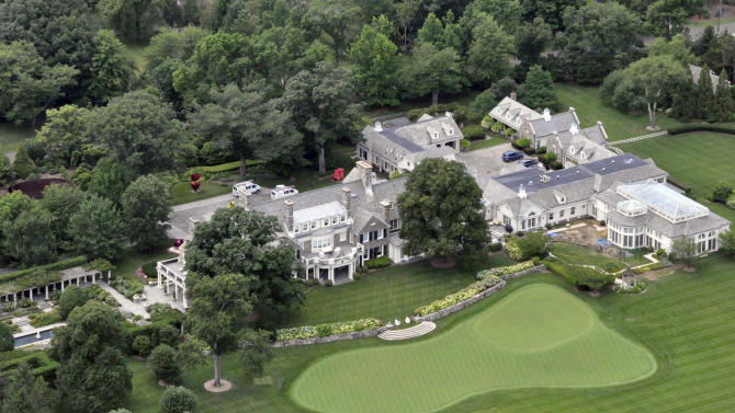 FILE -This Friday, July 26, 2013, file photo shows the Greenwich, Conn. estate belonging to billionaire hedge fund owner Stephen Cohen, Cohen's company, hedge fund giant SAC Capital Advisors agreed Monday, Nov. 4, 2013, to plead guilty to fraud charges and to pay a $1.8 billion financial penalty. (AP Photo/Vincent T. Vuoto, File)
