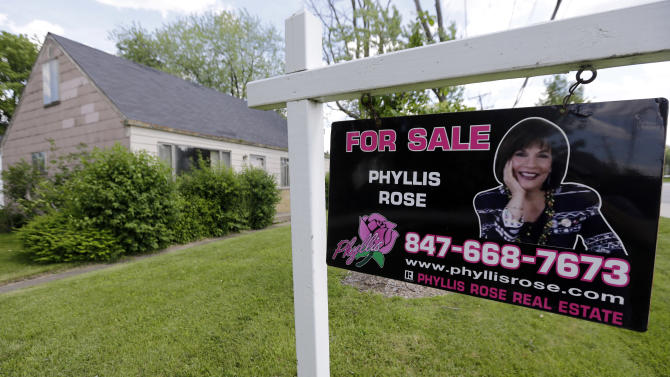 A home is for sale in Glenview, Ill., on Sunday, June 16, 2013. Average U.S. rates on fixed mortgages surged the week of June 24, 2013, to their highest levels in two years, and the rate on the 30-year loan jumped by the most in 26 years. The increase is evidence that the Federal Reserve's comments about possibly reducing its bond purchases are already affecting consumers. (AP Photo/Nam Y. Huh)