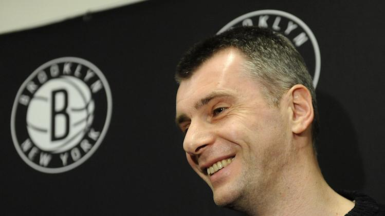 Brooklyn Nets principal owner Mikhail Prokhorov smiles as he speaks to the media concerning the firing of head coach Avery Johnson.  Prokhorov spoke at half time of an NBA basketball game against the Charlotte Bobcats on Friday, Dec., 28, 2012 at Barclays Center in New York. (AP Photo/Kathy Kmonicek)