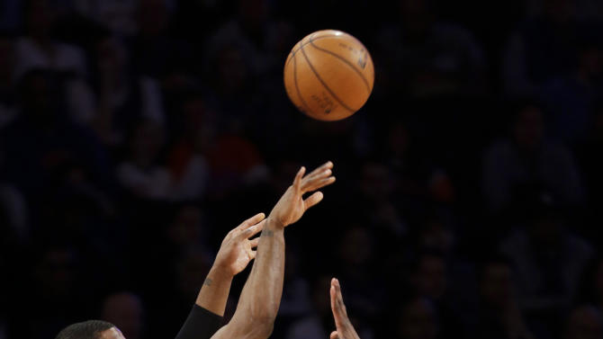 Brooklyn Nets guard Joe Johnson (7) shoots a 3-pointer over New York Knicks guard Iman Shumpert (21) in the first half of their NBA basketball game at Madison Square Garden in New York, Monday, Jan. 21, 2013. (AP Photo/Kathy Willens)