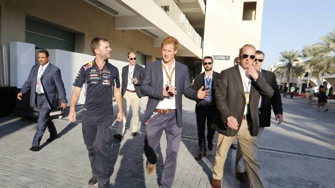 Britain's Prince Harry walks on the track before the start of the Abu Dhabi F1 Grand Prix at the Yas Marina circuit in Abu Dhabi