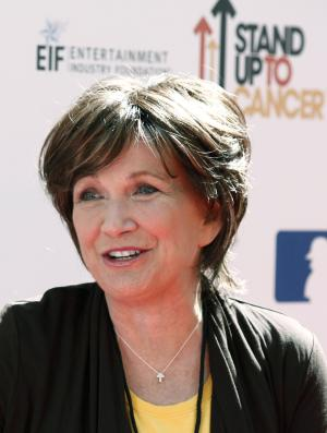 "FILE - In this Sept. 10, 2010 file photo, Elizabeth Edwards arrives at the ""Stand Up To Cancer"" television event at Sony Studios in Culver City, Calif.  A family friend on Tuesday, Dec. 7, 2010 said Edwards has died after a battle with cancer. She was 61. (AP Photo/Matt Sayles, File)"