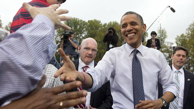 President Barack Obama shakes hands with supporters after speaking about the choice facing women in the upcoming election, Friday, Oct. 19, 2012, at a campaign event at George Mason University, in Fairfax, Va. (AP Photo/Carolyn Kaster)