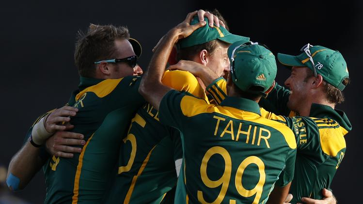 South Africa's captain de Villiers celebrates with teammates Morkel, Miller, and Tahir during their final One Day International cricket match in Hambantota
