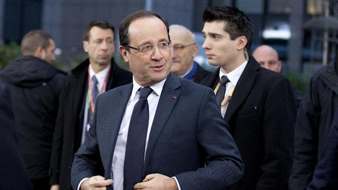 French President Francois Hollande, center, arrives for an EU summit in Brussels on Thursday, Dec. 13, 2012. In one whirlwind morning, the European Union nations agreed on the foundation of a fully-fledged banking union and Greece's euro partners approved billions of euros in bailout loans that will prevent the nation from going bankrupt. (AP Photo/Virginia Mayo)