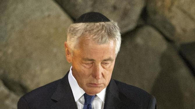 US Secretary of Defense Chuck Hagel stands in a moment of silence after placing a wreath at the Hall of Remembrance as he tours Yad Vashem in Jerusalem, on Sunday, April 21, 2013.  (AP Photo/Jim Watson, pool)