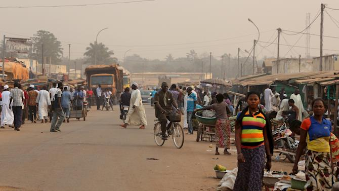 Pedestrians walk on a street ahead of Sunday's second round of presidential elections in Bangui