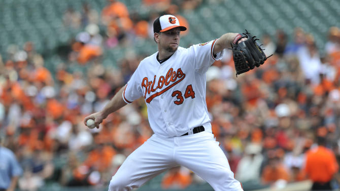 Baltimore Orioles pitcher Scott Feldman Delivers against the Toronto Blue Jays in the first inning of a baseball game on Sunday, July 14, 2013, in Baltimore. (AP Photo/Gail Burton)