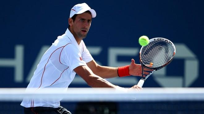 Novak Djokovic hits a backhand shot during his 4-hour match againstStanislas Wawrinka at the US Open semifinals on Saturday.