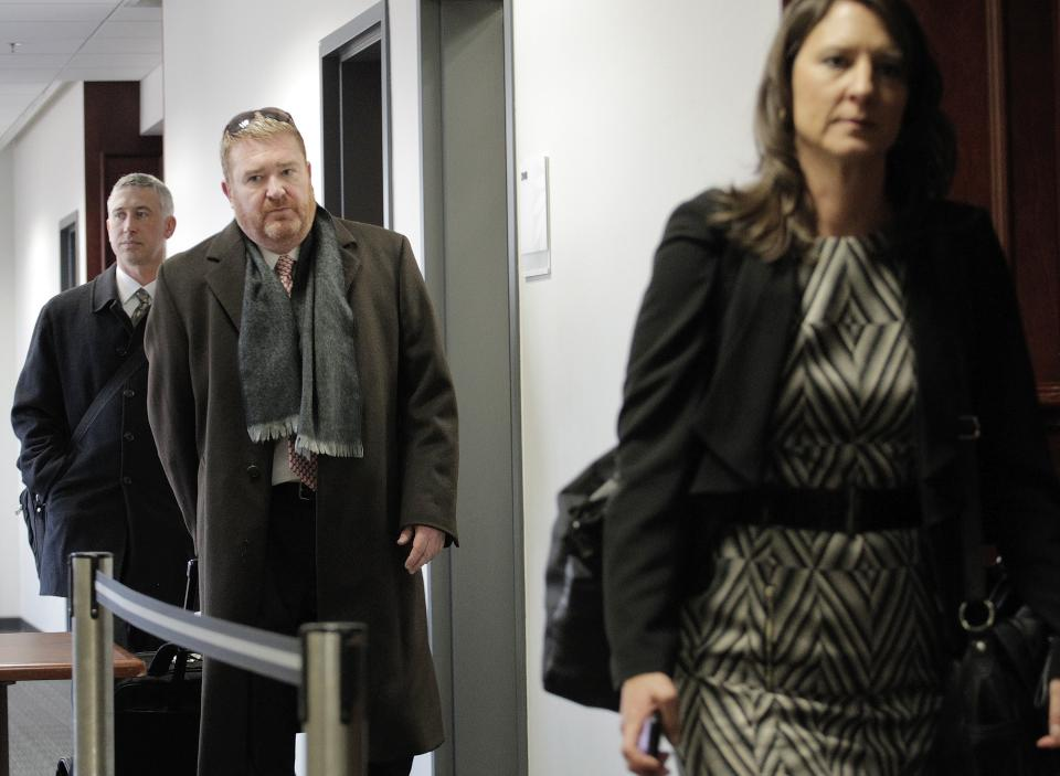 Defense attorney Daniel King, center, and members of his team leave a hearing for his client Aurora theater shooting suspect James Holmes at the courthouse in Centennial, Colo., on Wednesday, April 10, 2013. (AP Photo/Ed Andrieski)