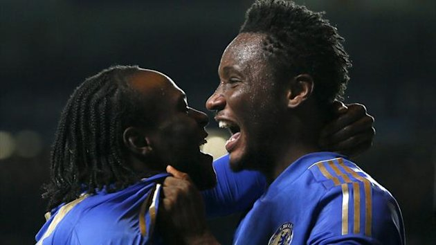 Chelsea&#39;s Victor Moses (L) celebrates with team mate John Obi Mikel after scoring a goal during their Champions League Group E match against Shakhtar Donetsk at Stamford Bridge (Reuters)