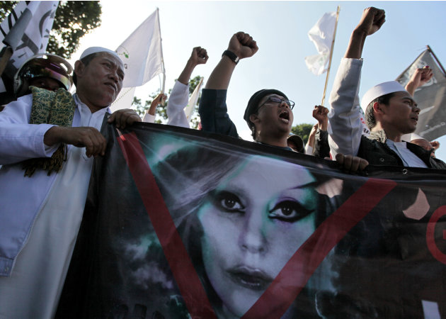 Muslim men shout slogans during a rally against U.S. pop singer Lady Gaga's concert that is scheduled to be held on June 3, outside the U.S. Embassy in Jakarta, Indonesia, Friday, May 25, 2012. Lady G