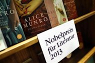 Books by Canadian writer Alice Munro, the 2013 Nobel Prize in Literature winner, are displayed during the book fair in Frankfurt, October 10, 2013. REUTERS/Ralph Orlowski