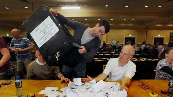 Ballot Boxes are opened as counting begins in European Fiscal Treaty Referendum at the Citywest Hotel in Dublin, Ireland Friday June 1, 2012. Saying yes could mean dooming Ireland to more long, hard years of austerity. But saying no could mean national bankruptcy next year. Ireland's debt-burdened voters confronted an existential dilemma Thursday as they decided in a referendum whether to ratify the European Union's deficit-fighting treaty, a measure backed by Germany as a confidence-building measure but criticized by many economists as exactly the wrong kind of medicine for countries drowning in red ink. Results come Friday. (AP Photo/Niall Carson/PA Wire)  UNITED KINGDOM OUT