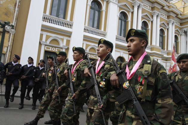 Bolivian soldiers Fernandez, Choque and Cardenas march with their medals during a rank-bestowing ceremony, in La Paz