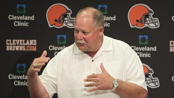 FILE - This Aug. 3, 2012 file photo shows Cleveland Browns president Mike Holmgren introducing Jimmy Haslam, the new majority owner of the Cleveland Browns, during a news conference in Berea, Ohio. The sale of the Browns to Haslam III was unanimously approved by NFL owners Tuesday, Oct. 16, 2012, and Holmgren will be leaving the Browns at the end of the season. A person familiar with the sale told The Associated Press that Joe Banner has been hired as CEO of the Browns to replace Holmgren. The person spoke on condition of anonymity because Banner's hiring and Holmgren's departure have not been announced.  (AP Photo/Jay LaPrete, File)