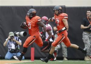 Backup QB Walsh leads Oklahoma State to 65-24 win