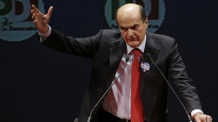 Italian center-left coalition leader Pierluigi Bersani delivers his speech during a campaign rally in Rome, Friday, Feb. 22, 2013. Amid corruption scandals, rising populist sentiment and financial hardship, Italians are voting in a watershed parliamentary election Sunday and Monday seen as a test of their will to stay the course for painful economic reforms or revert to their free spending ways of the past. Silvio Berlusconi, a billionaire forced out of office by Italy's debt crisis, is seeking a political comeback promising Italians to give them back the real estate tax they paid as part of austerity measures enacted to salvage the economy. (AP Photo/Gregorio Borgia)
