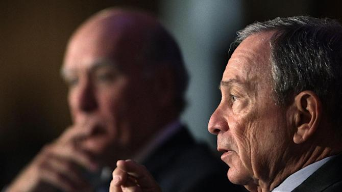 New York City Mayor Michael Bloomberg, right, and former White House Chief of Staff William Daley take part in a discussion of economics and the politics of immigration during a meeting of The Chicago Economic Club Tuesday, Aug. 14, 2012, in Chicago. (AP Photo/M. Spencer Green)
