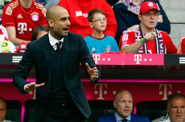 Guardiola coach of FC Bayern Munich gestures during their German first division Bundesliga soccer match against Hertha Berlin in Munich