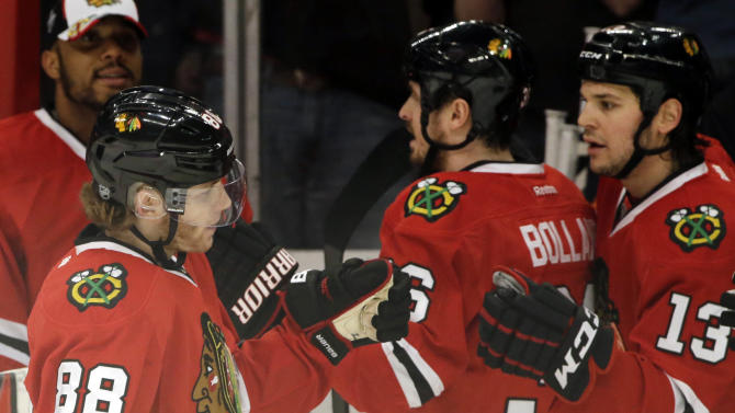 Chicago Blackhawks' Patrick Kane (88) celebrates with teammates after scoring a goal against the Detroit Red Wings during the first period of Game 2 of an NHL hockey Stanley Cup playoffs Western Conference semifinals Saturday, May 18, 2013, in Chicago. (AP Photo/Nam Y. Huh)
