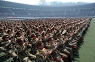 North Korean soldiers applaud as they listen a speech during an official ceremony attended by leader Kim Jong-Un at a stadium in Pyongyang on Saturday. Tens of thousands of people gathered in a football stadium Saturday to shout support for North Korea&#39;s ruling dynasty, a day after a failed rocket launch seen as a major embarrassment for the regime