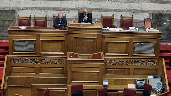 Parliament speaker Evangelos Meimarakis speaks as empty benches are seen in front of him, after a debate was briefly interrupted by a wildcat strike by parliament employees in Athens, Wednesday, Nov. 7, 2012. Greece's fragile coalition government faces its toughest test so far when lawmakers vote late Wednesday on new painful austerity measures demanded to keep the country afloat, on the second day of a nationwide general strike. (AP Photo / Thanassis Stavrakis)