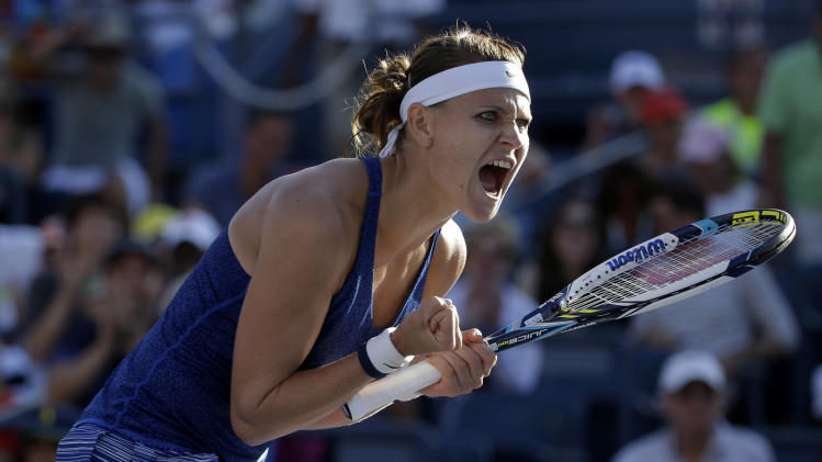 Lucie Safarova, of the Czech Republic, reacts after defeating Alize Cornet, of France, during the third round of the 2014 U.S. Open tennis tournament, Friday, Aug. 29, 2014, in New York. (AP Photo/Frank Franklin II)