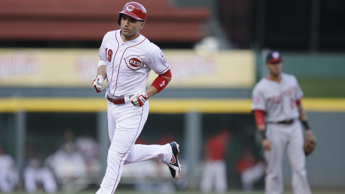 Cincinnati Reds' Joey Votto rounds the bases after hitting a solo home run in the first inning of a baseball game against the Washington Nationals, Friday, May 29, 2015, in Cincinnati. (AP Photo/John Minchillo)