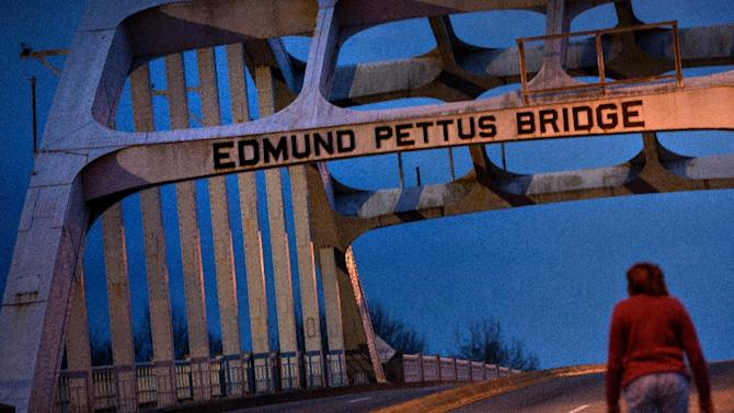 A woman walks across the Edmund Pettus Bridge, on March 4, 2015 in Selma, Alabama ahead of the 50th anniversary of a seminal moment in America's democracy when some 600 rights activists were attacked by police with clubs and tear gas at the bridge