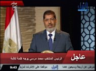 An image grab taken from Egypt&#39;s NILE TV shows Muslim Brotherhood&#39;s Mohamed Morsi, Egypt&#39;s first president following the ouster of Hosni Mubarak, speaking to the nation in a televised address. Egypt&#39;s Mohamed Morsi, the first Islamist to be elected to the presidency, said on Sunday he will be a leader &quot;for all Egyptians.&quot;