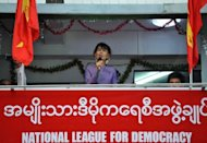 Myanmar opposition leader Aung San Suu Kyi speaks at the opening of a National League for Democracy office in Yangon's Hlaing township on Monday. Suu Kyi will address an International Labour Organization conference in Geneva next month during her first trip outside Myanmar in 24 years, the ILO says