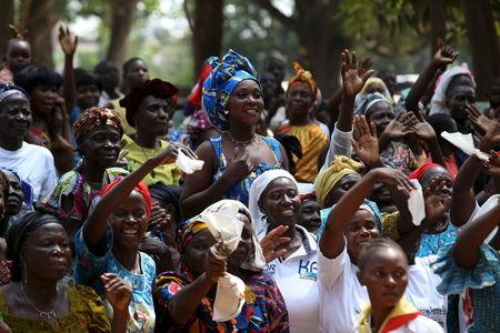 Internally displaced people sheltering on the grounds of the Saint Sauveur church greet Pope Francis, during his visit to the capital Bangui, Central African Republic