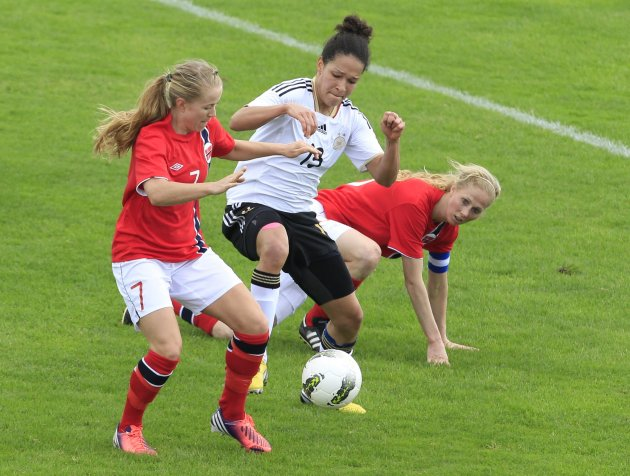 Norway's Mykjaland and Gulbrandsen fight for the ball with Germany's Da Mbabi during their women's Algarve Cup soccer match in Lagos