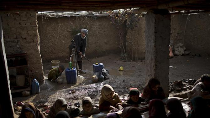 In this Saturday, Feb. 21, 2015, photo, a boy washes himself before joining other internally displaced Pakistani children from tribal areas attending madrassa, or Islamic school, set up in a mosque on the outskirts of Islamabad, Pakistan. There's no exact number of madrassas in Pakistan but estimates put the number in the tens of thousands. They provide food, housing and a religious education to students from around the country. (AP Photo/Muhammed Muheisen)