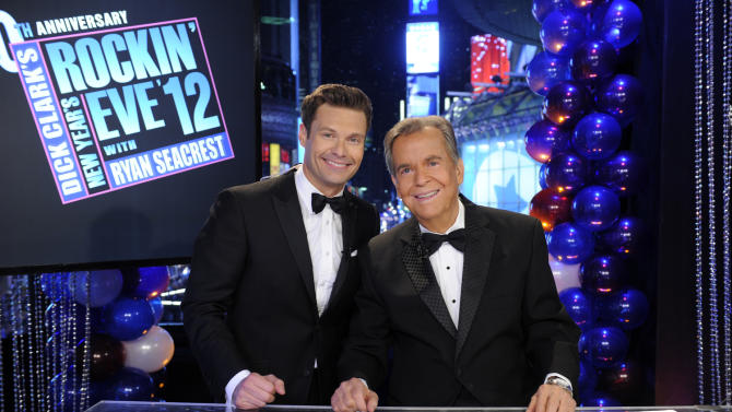 "In this Dec. 31, 2011 photo released by ABC, hosts Dick Clark, right, and Ryan Seacrest pose on the set of ""Dick Clark's New Year's Rockin' Eve with Ryan Seacrest 2012"" in Times Square in New York. Clark, the ever-youthful television host and tireless entrepreneur who helped bring rock `n' roll into the mainstream on ""American Bandstand,"" and later produced and hosted a vast range of programming from game shows to the New Year's Eve countdown from Times Square, died of a heart attack on Wednesday, April 18, 2012. He was 82.  (AP Photo/ABC, Ida Mae Astute)"
